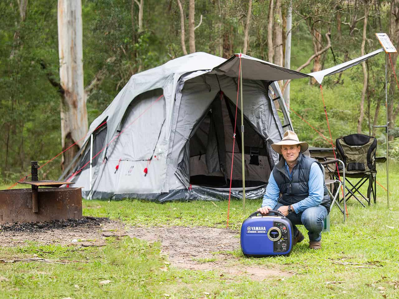 Pat Callinan with a Yamaha EF2000iS portable inverter generator at a camping site