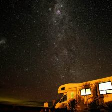 RV / Caravan parked under starry sky